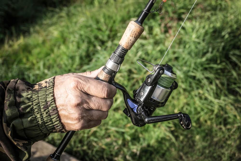 como pescar com molinete entendendo o molinete